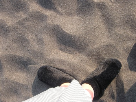 My feet walking in the soft sand along Lake Superior